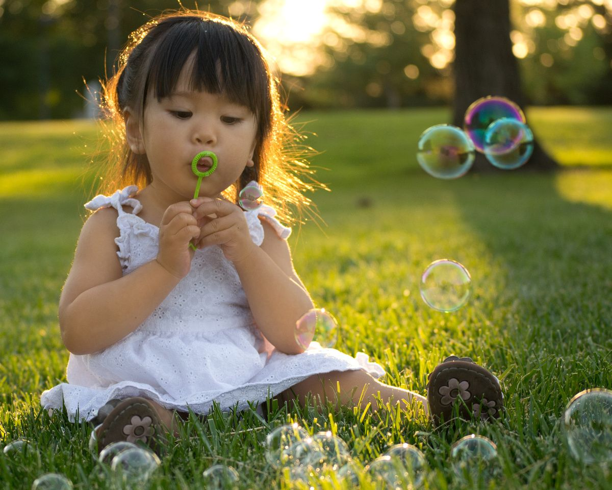 candid kids children, child, candid, bubbles, sun flare, photography, back lit,