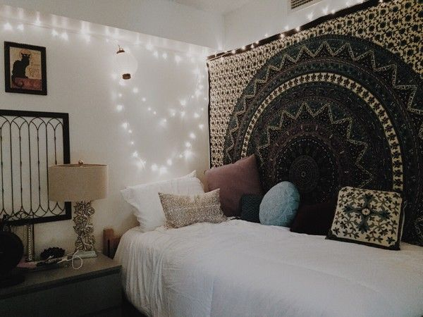 Tapestry textile cloths hanging from wall with accent lights ...