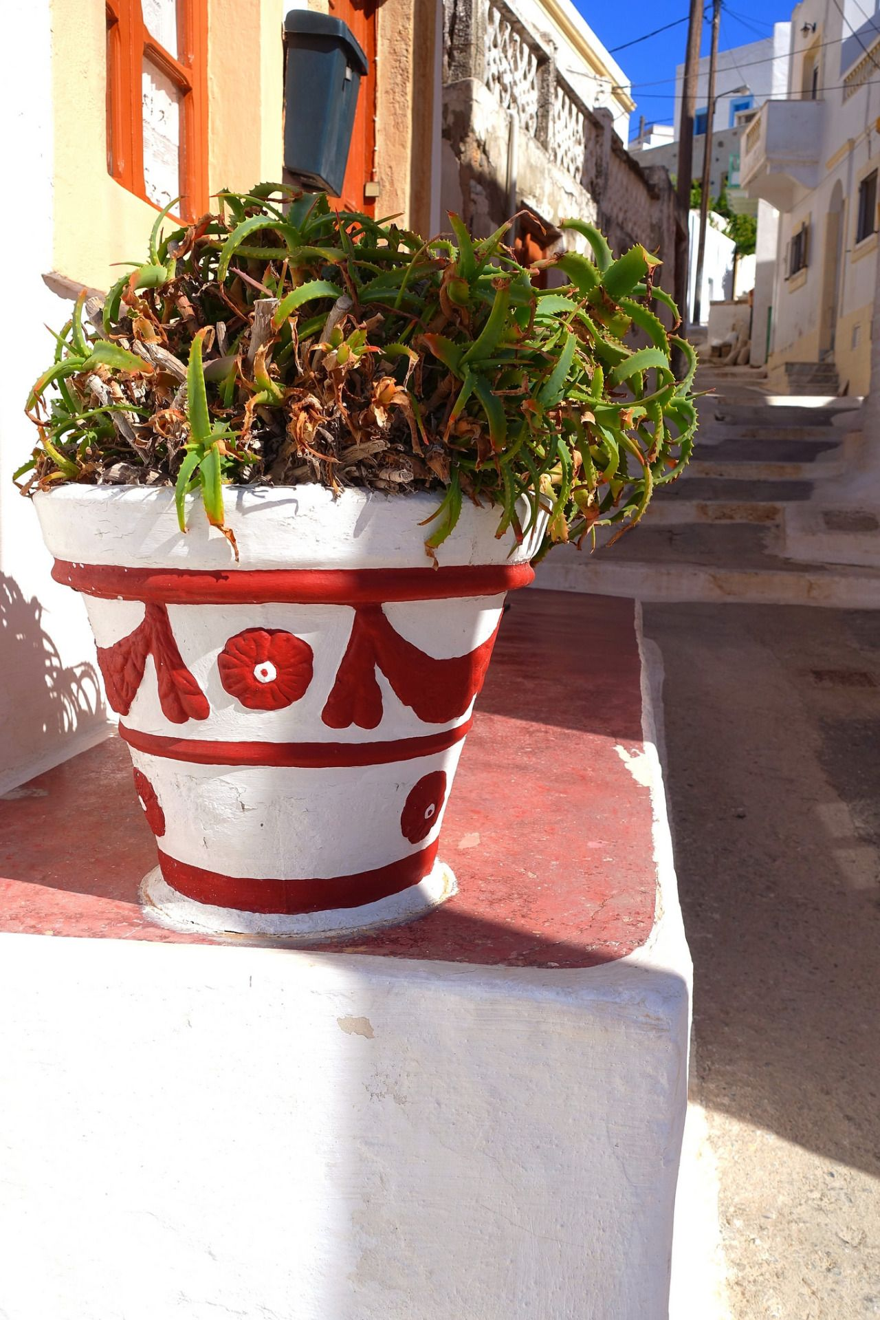 Alley with pot by Marie Therese Magnan     Pot and alley. Platanos, Leros island, Dodecanese, Greece