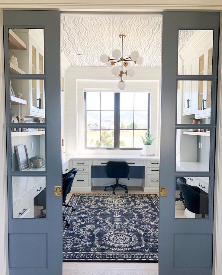Four Chairs Furniture  Design on Instagram Blue pocket doors and a wallpapered ceiling What is Blue pocket doors and a wallpapered ceiling What is there not to love about...