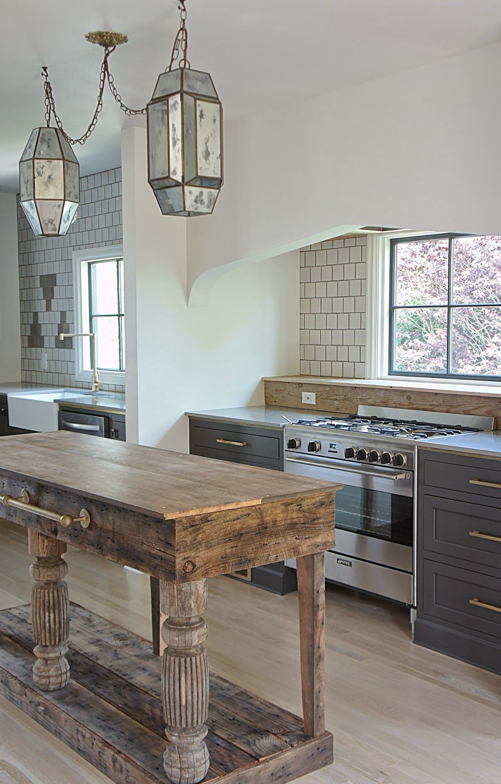 Kitchen Island Uses A Mix Of Repurposed Table Legs And Planks