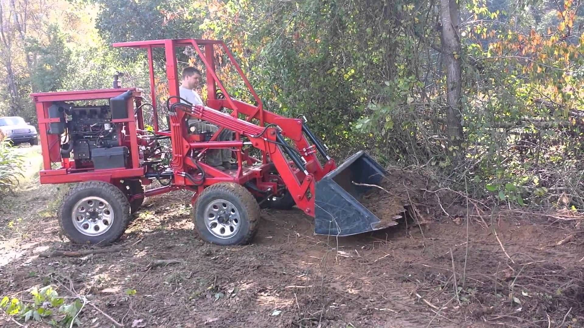 articulating tractor front end loader clearing brush homemade homemade tractors. Black Bedroom Furniture Sets. Home Design Ideas