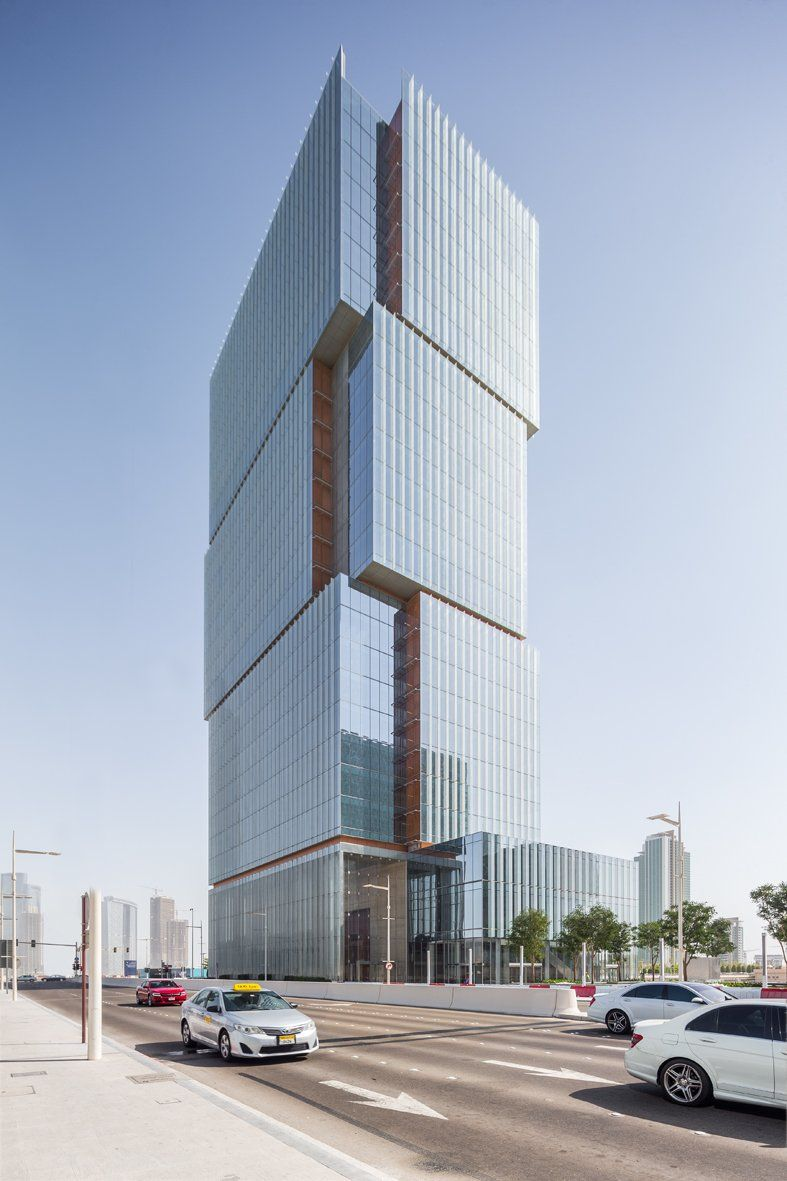 The Al Hilal Bank Office Tower project represents an exceptional design opportunity on a highly visible and distinguished site on Al Maryah Island in Abu Dhabi. We developed a design solution that offers a unique building image derived from a combination of program, site and contextual influences. We have strived to achieve a distinctive statement in the form of a sophisticated building while maintaining the value and efficiency that will make this a successful project in the local office…