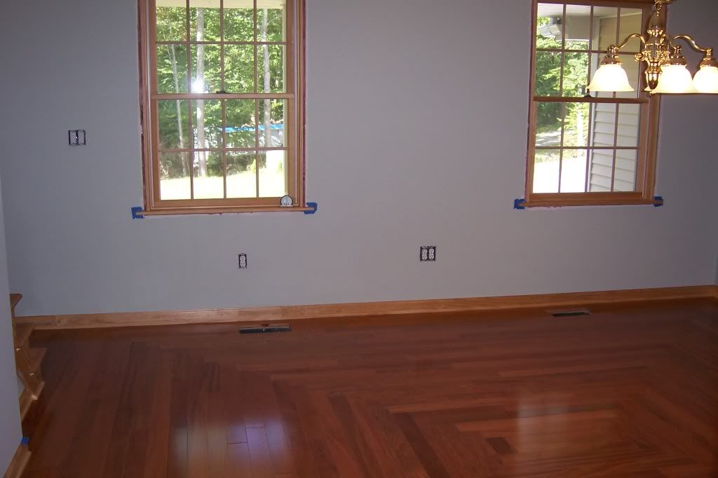Darker Wood Floor With Lighter Wood Trim And Gray Walls