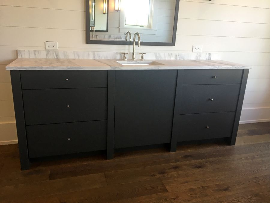 A Close Up Of The Custom Dark Grey Bathroom Vanities