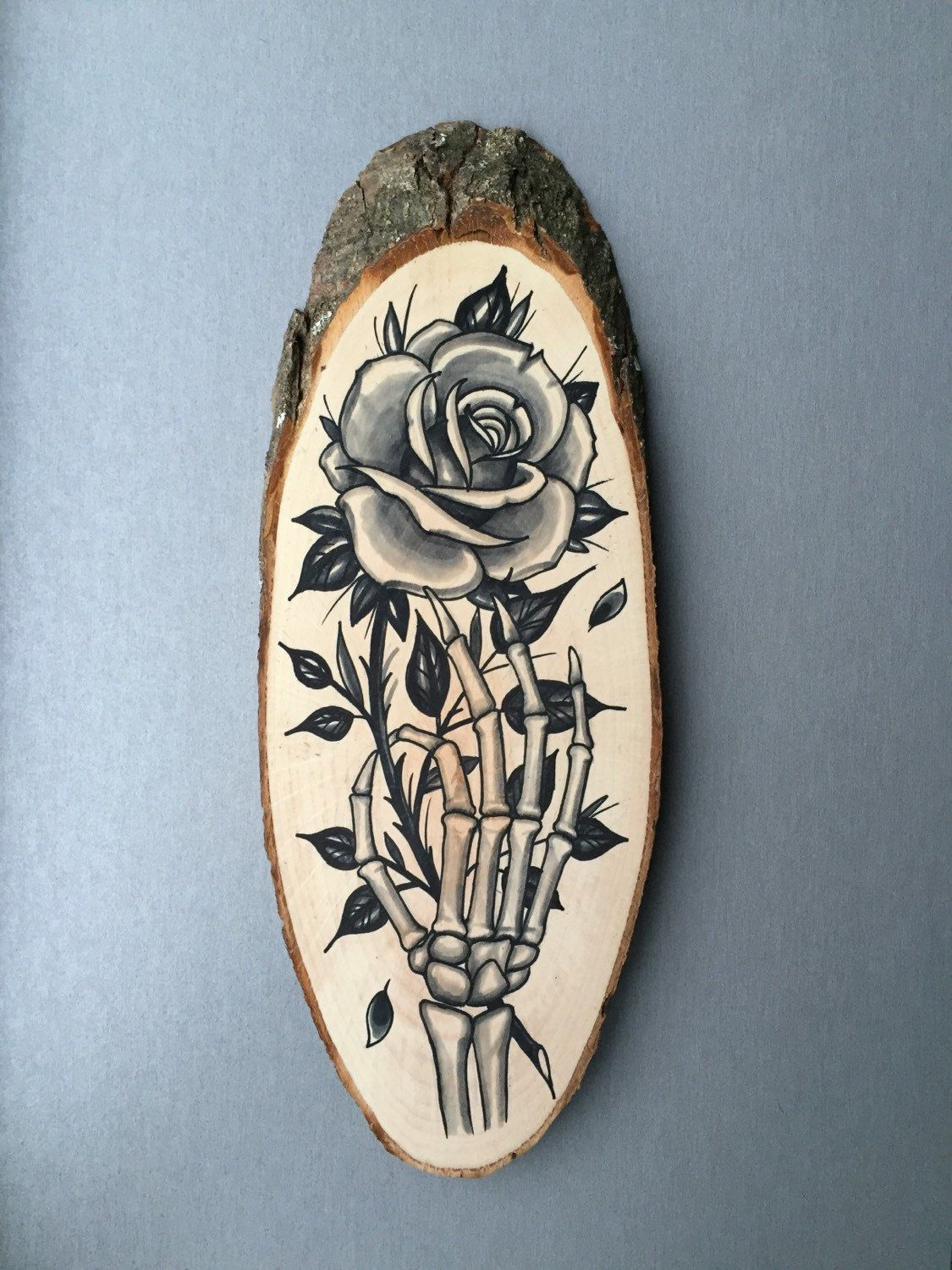Large wood slice with original drawing of a skeleton hand