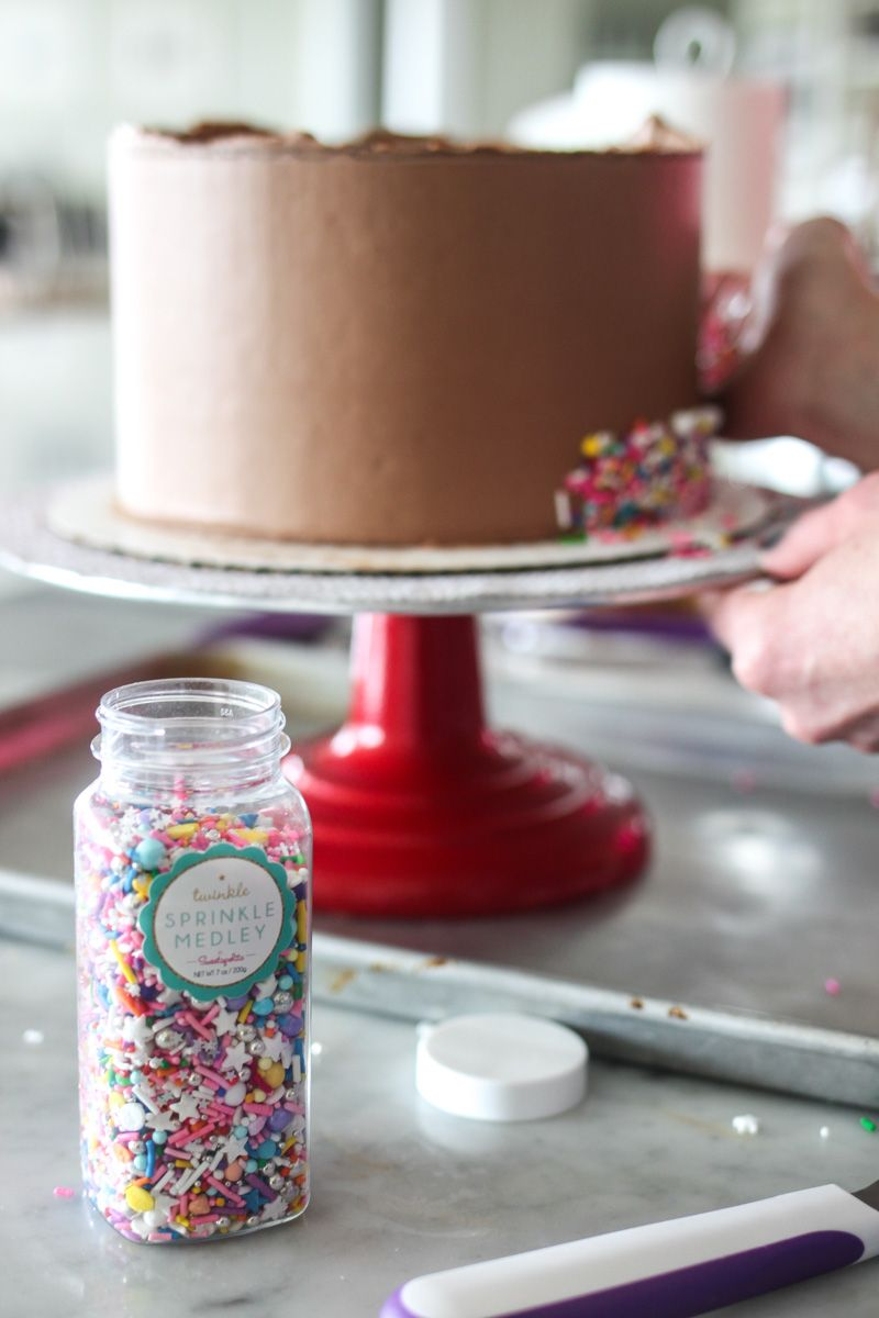How To Add Sprinkles To The Side Of Your Cake Cake By Courtney Sprinkles Cake Diy Lemon And Coconut Cake Sprinkles Cake Tutorial