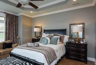 Traditional Master Bedroom with flush light, Ceiling fan, Crown molding, Tipton Trellis Single Curtain Panel, Hardwood floors