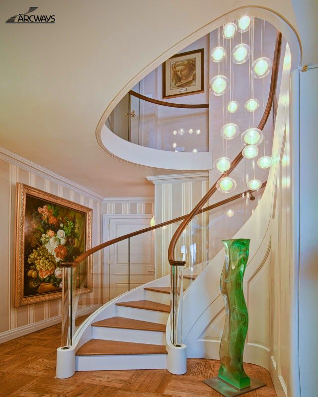 stair railing ideas snail stair design with glass handrail - Stairs Design Ideas