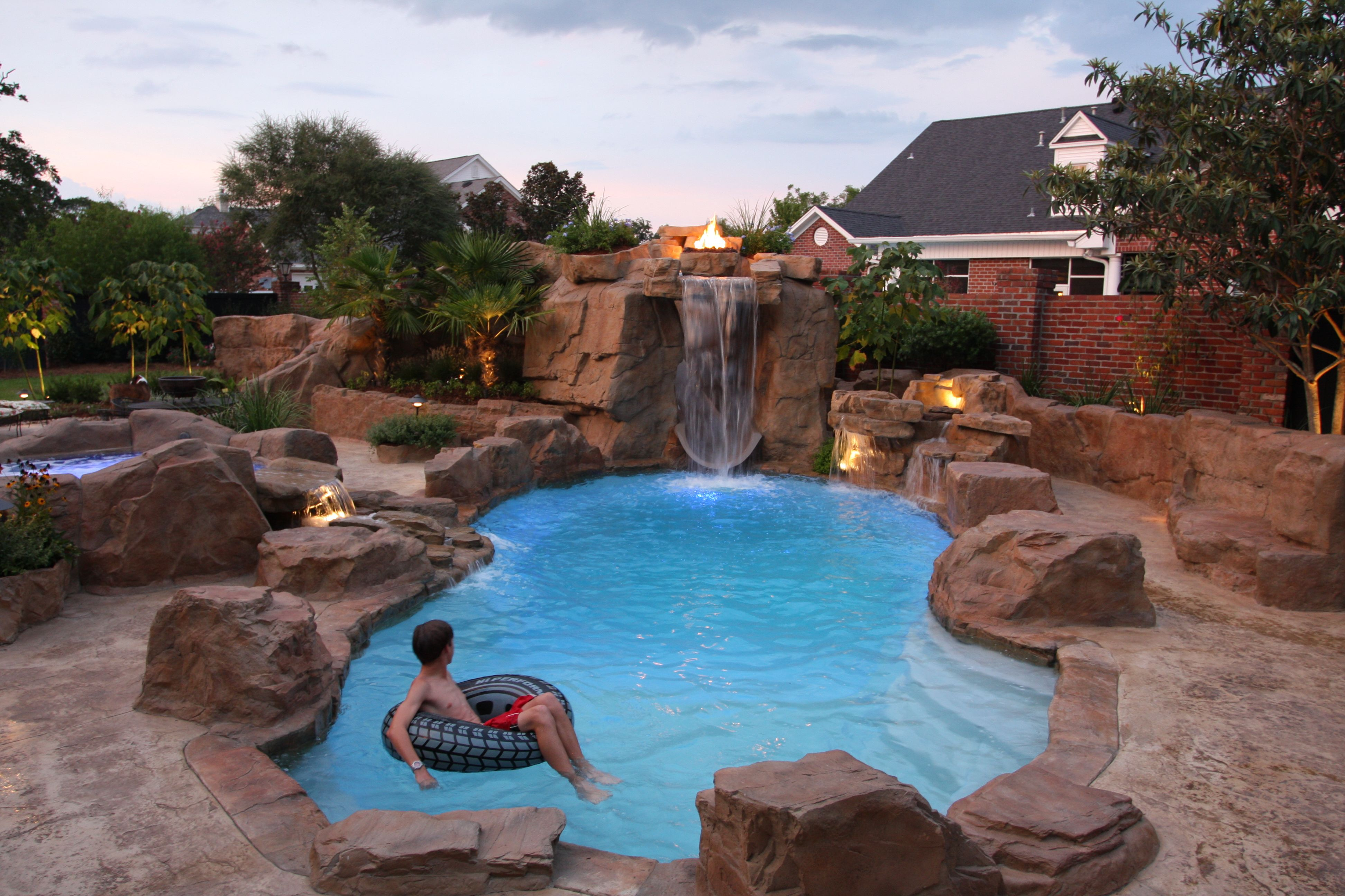 Charming Inground Fiberglass Swimming Pool By Royal Fiberglass Pools, A Viking Pools  / Trilogy Pools Company. Rico Rock Waterfall, Retaining Wall And Spa.