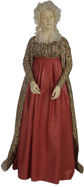 """Robe: 1795-1800, English, block-printed and glazed cotton, lined with linen, silk ribbon. """"...Cotton was a very popular fabric for clothing, from sheer muslins to heavy corduroys. It was part of the wardrobe of all classes. This printed cotton gown of the late 1790s could have been the Sunday best of a working-class woman or the informal morning gown of a wealthy lady. The very high waist and long sleeves are the typical fashion of this period."""""""