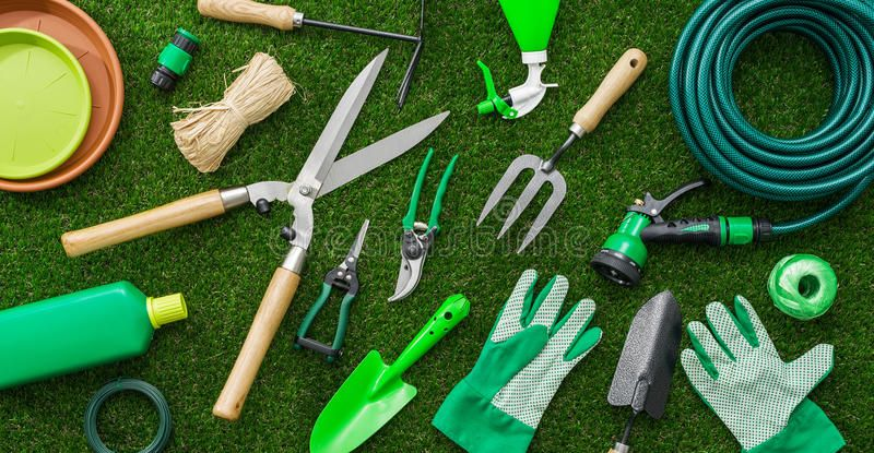 Gardening Tools And Utensils On A Lush Green Meadow Top View