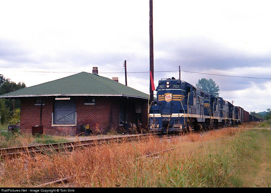 TAG 707 leads a mixed freight by the depot at Menlo, GA during the last month of TAG's operations.