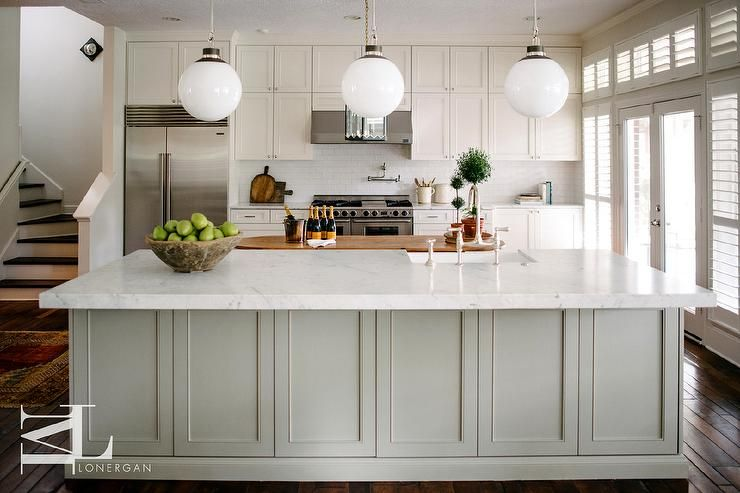 Large Oval Center Kitchen Island With Gray Wainscoting Topped With