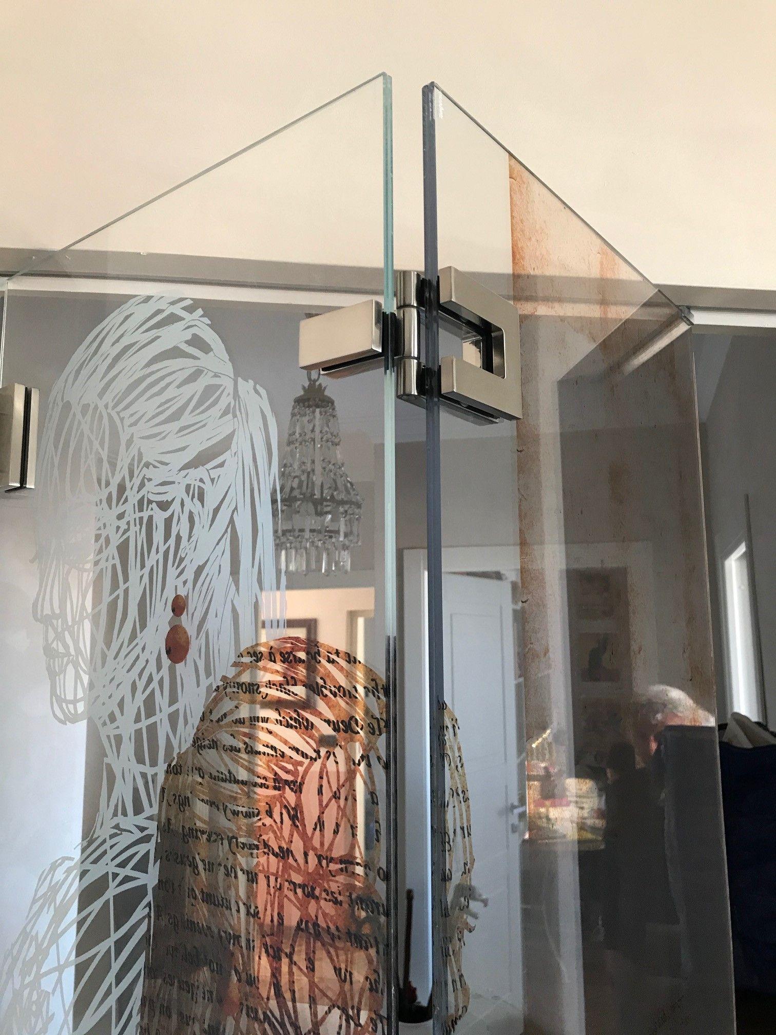 Sistema a soffietto per porte in vetro extra chiaro con stampa ...