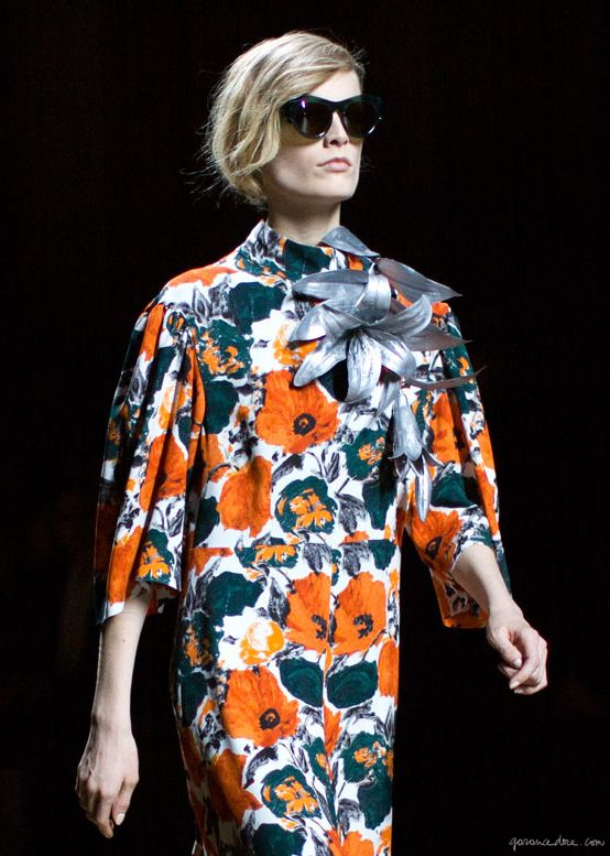Dries van Noten F/W 2014, floral dress, metallic flower accessory, sunglasses / Garance Doré