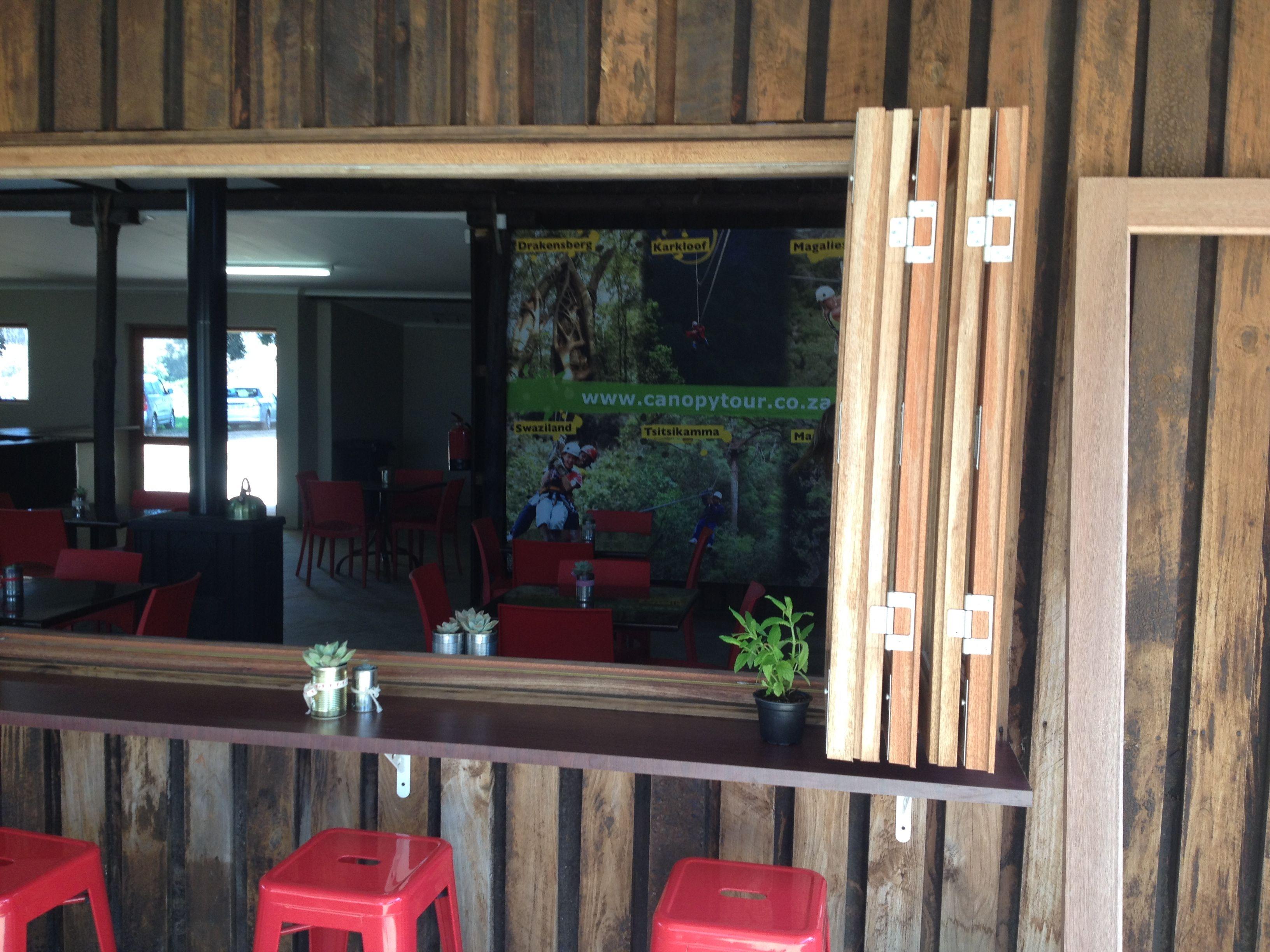 Folding windows in coffee shop folding doors cape town for Folding window