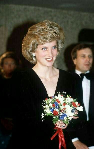 """October 08, 1985: Princess Diana attending a performance of """"Les Miserables"""" at the Barbican in London, wearing a black velvet Bruce Oldfield gown. [not Oct 10, 1985 - was in Lancs - unless returned in time!!]"""