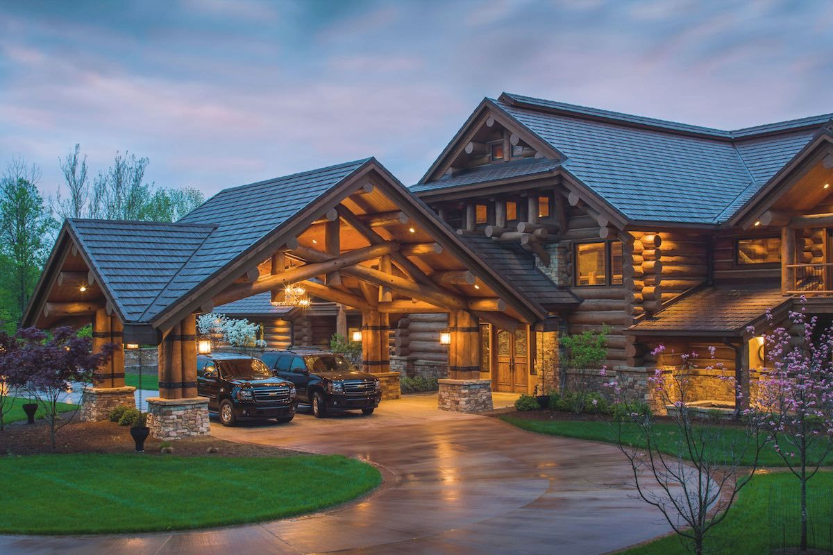 Discover western lodge log home designs from pioneer log for Large luxury homes