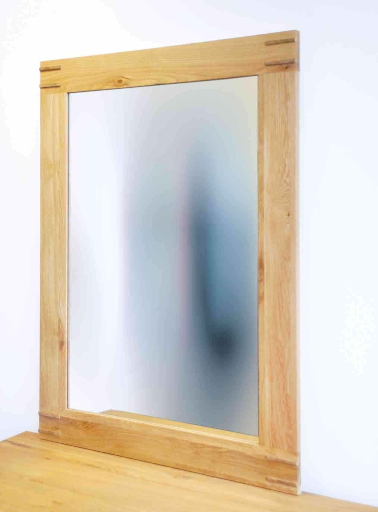 This Oak Framed Wall Mirror Adds Depth To Your Room