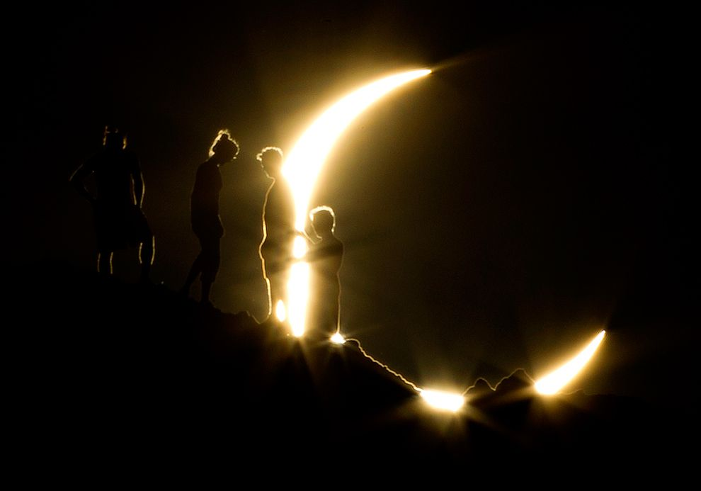 Ring of Fire Eclipse: 2012 - The Big Picture - Hikers watch an annular eclipse from Papago Park in Phoenix, May 20, 2012 by Michael Chow/The Arizona Republic