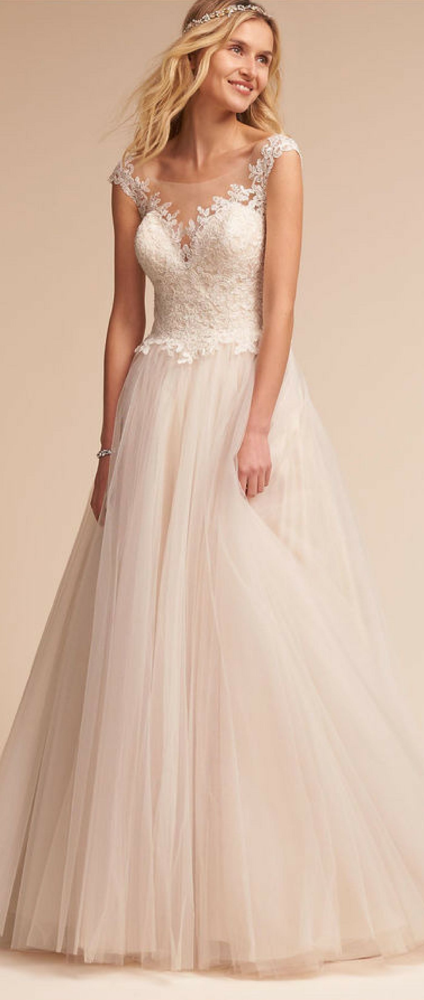 A ballgown silhouette ethereal layers of english net and lacy
