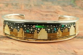 Starry Night at Monument Valley. Featuring Genuine Picture Japer and Black Jade inlaid in Sterling Silver. Beautiful Fire and Ice Lab Opal Moon and Shooting Star! Stunning Bracelet Designed by Navajo Artist Calvin Begay. Signed by the artist.