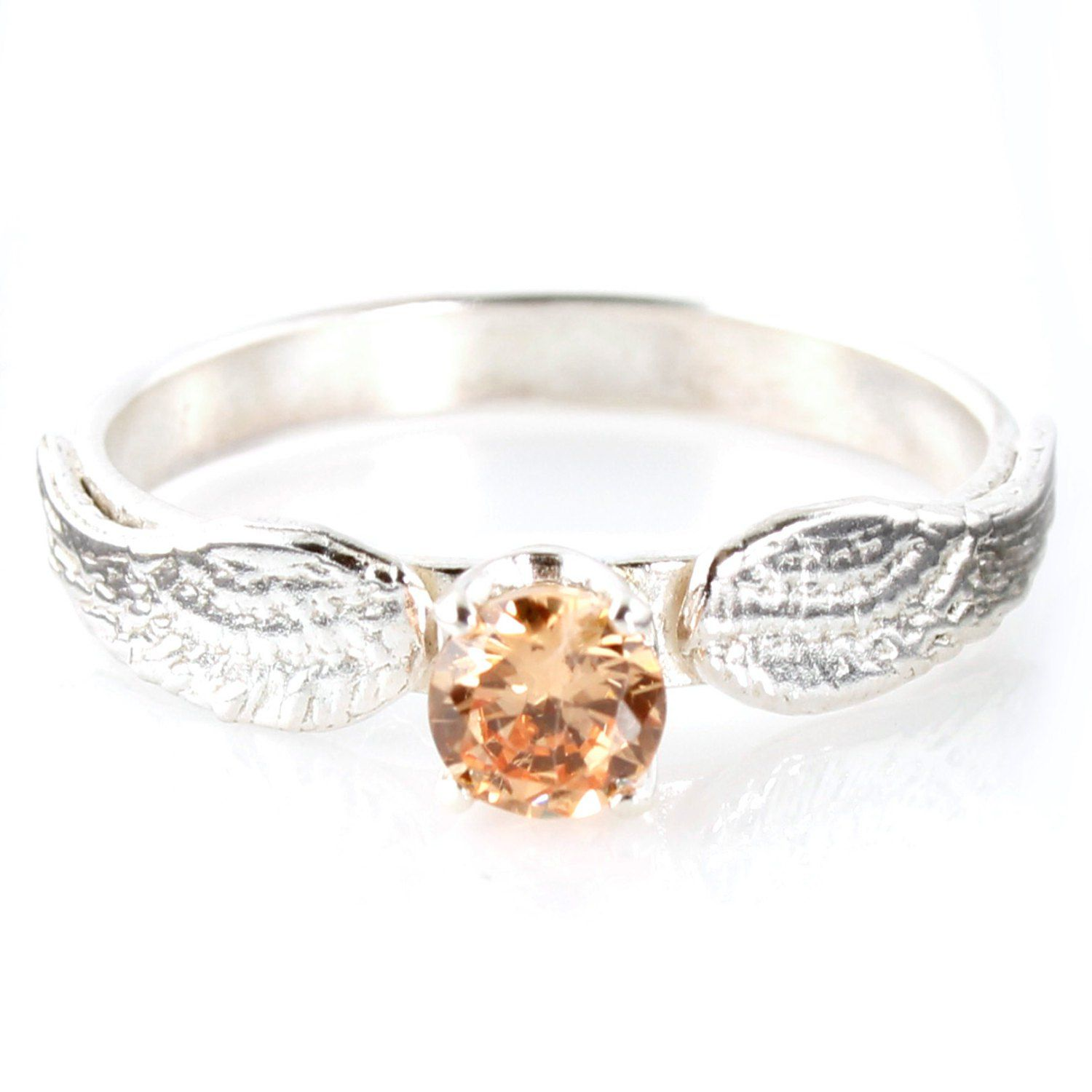Golden snitch engagement rings as seen on offbeatbride
