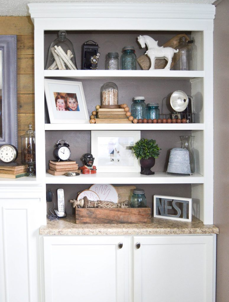 15 Budget Room Makeovers You Have To See: Reclaimed Barn Wood To Make Over The Family Room Mantel