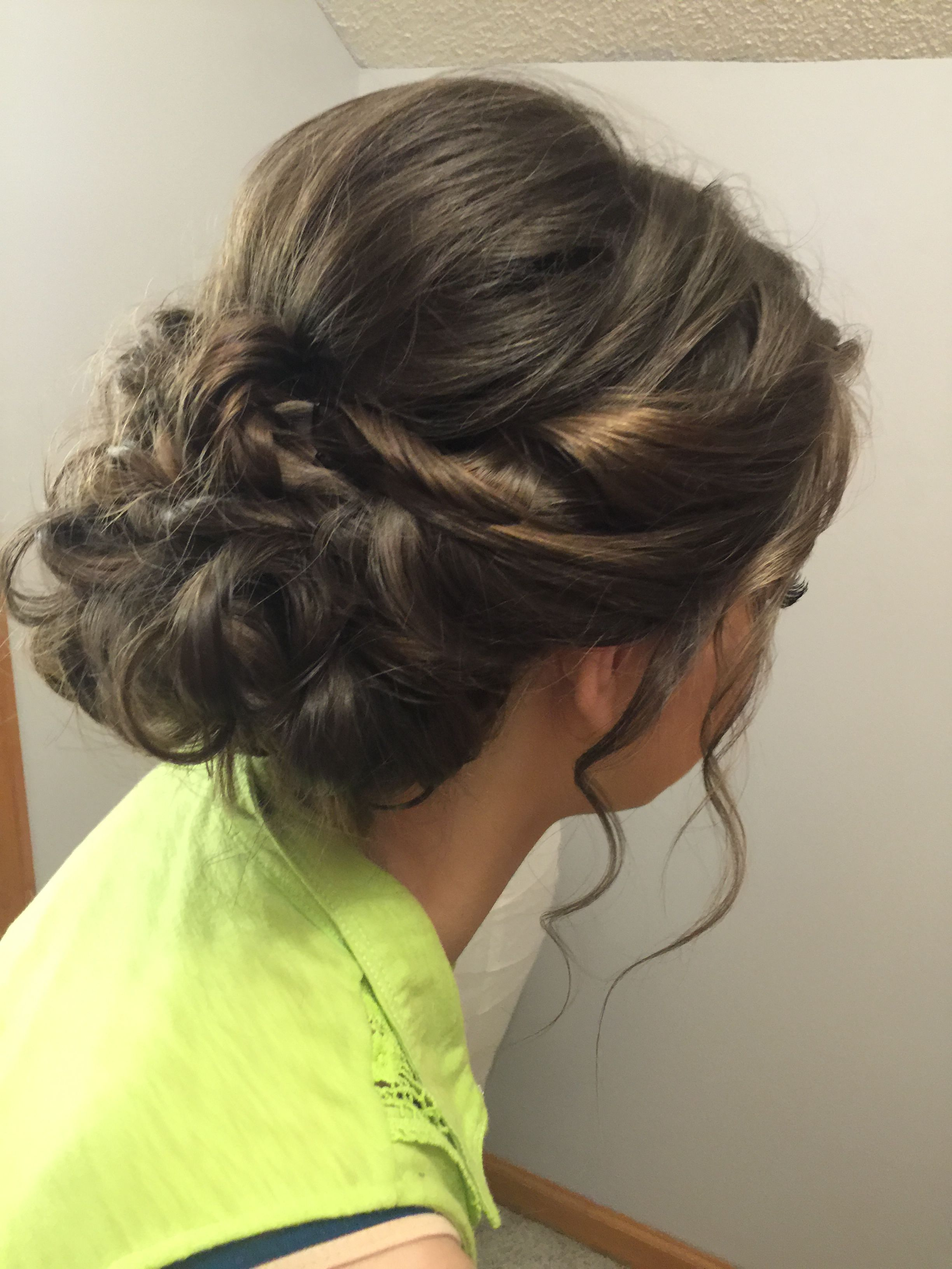 Elegant Prom hair with twists and loose curls.