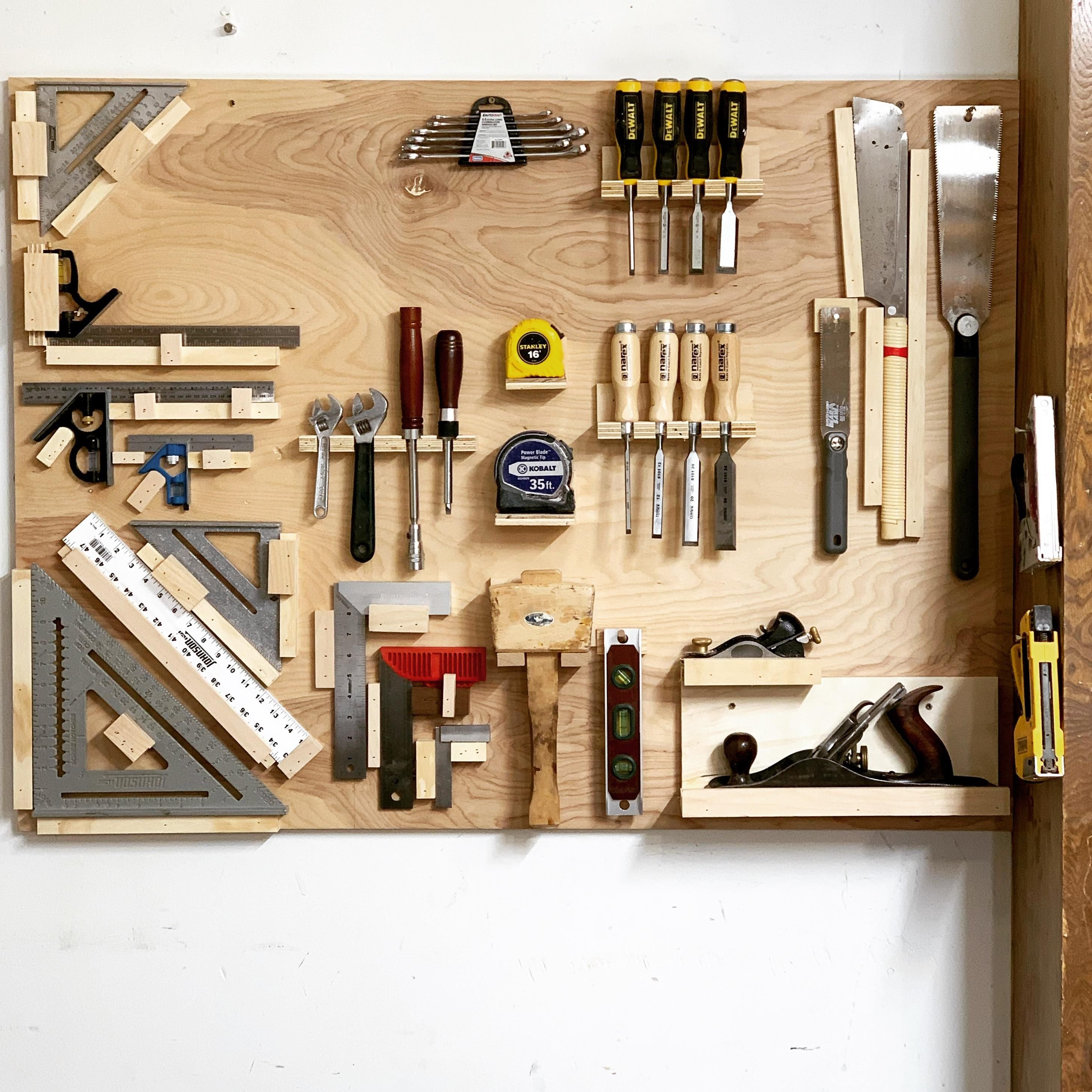 I made a small tool wall from left over plywood. Click to ...