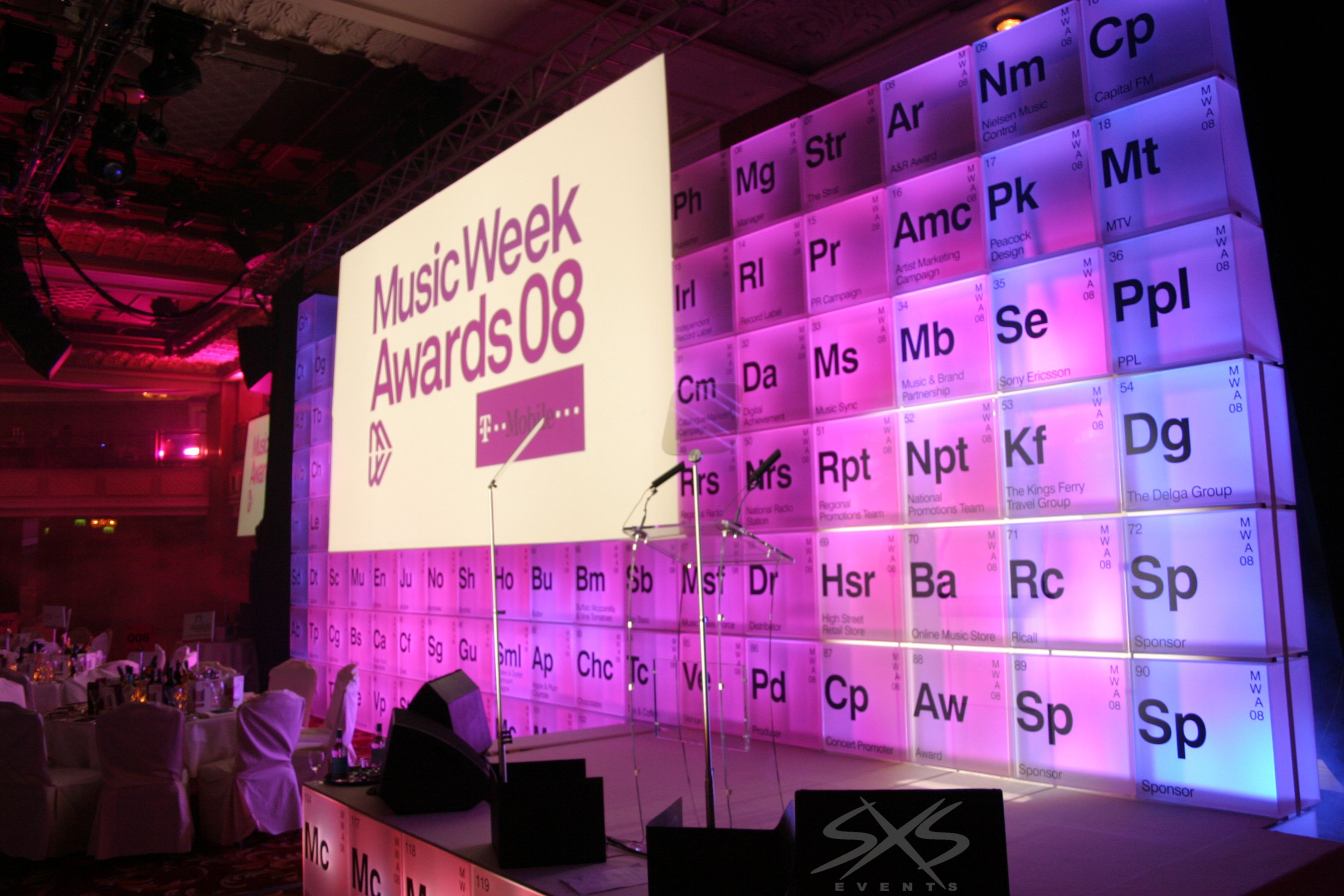 Custom glowing cube set for Music week awards, with perspex lectern and autocue. www.sxsevents.co.uk