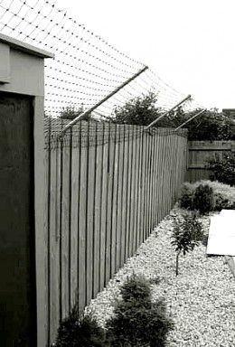 the angled flexible netting is the best catproof fence but it has to