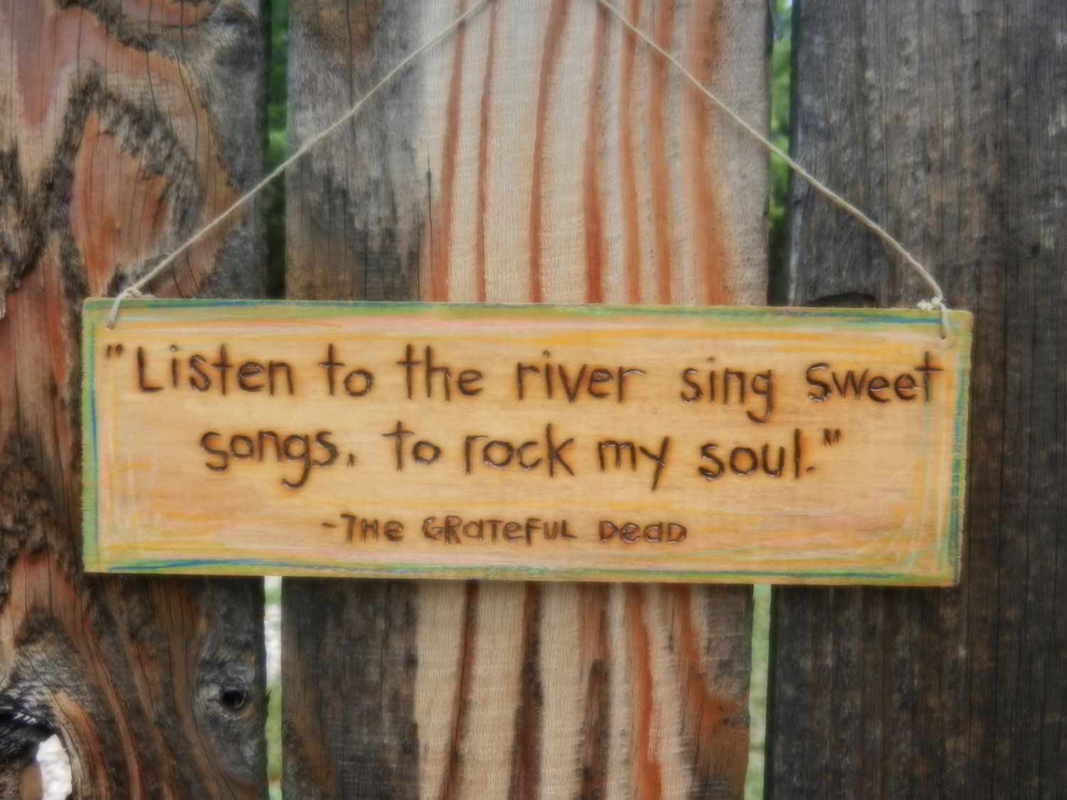 Listen to the river sing sweet songs, to rock my soul\