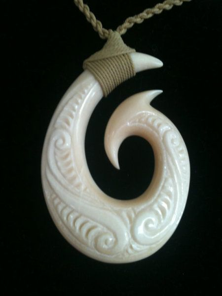 This exquisite fish hook necklace features a bone pendant for Maui fish hook necklace
