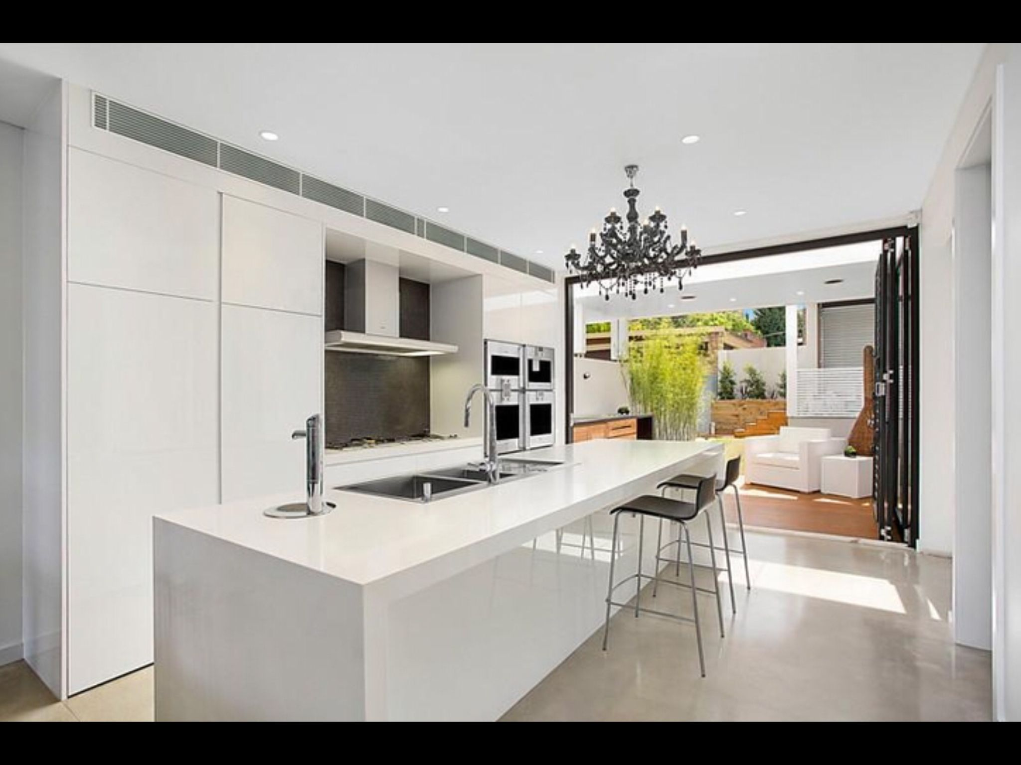 White modern kitchen renovation #openplan #stone #island ...