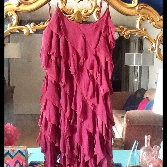 bebe asymmetrical cascading ruffle sexy dress! Cute little ruffle dress made by bebe. It's a size small. Great condition! Only worn 2x's. It is 100% silk! Last image shows true color, sorry the lighting was to bright in the first three. bebe Dresses