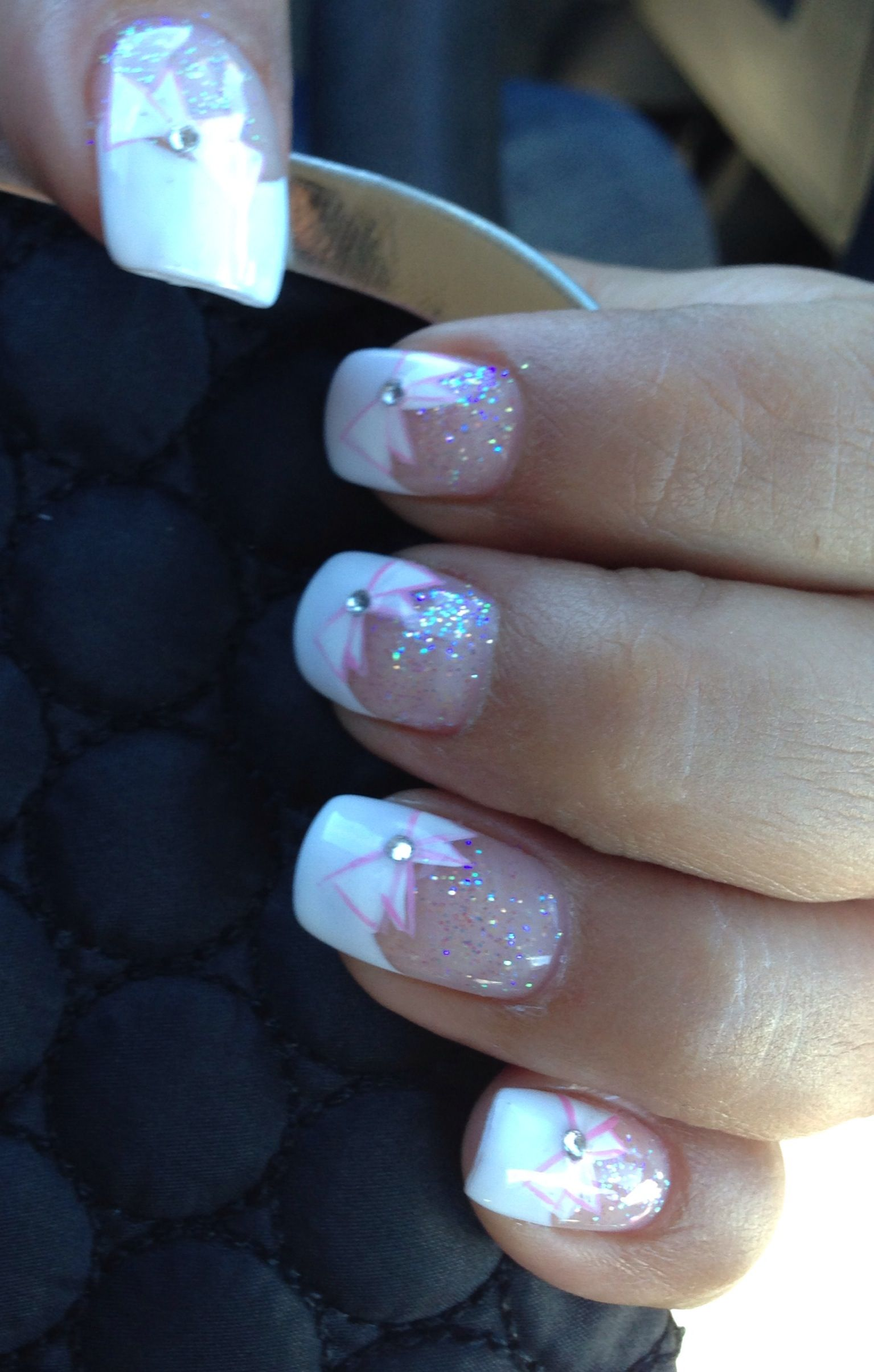 White French tip holiday nails with glitter pink bow and sparkle ...
