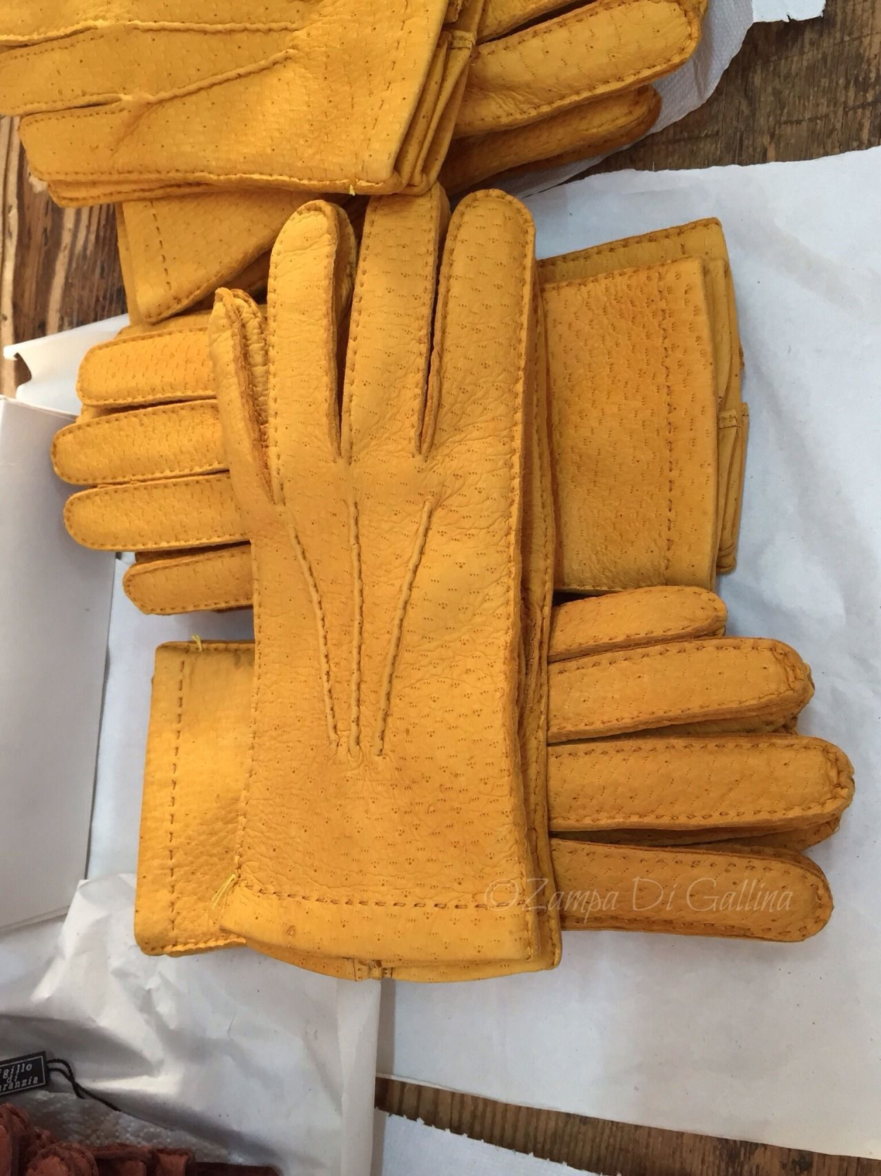 "zampa-di-gallina: "" At the end of the process, Mauro checks every glove individually. """