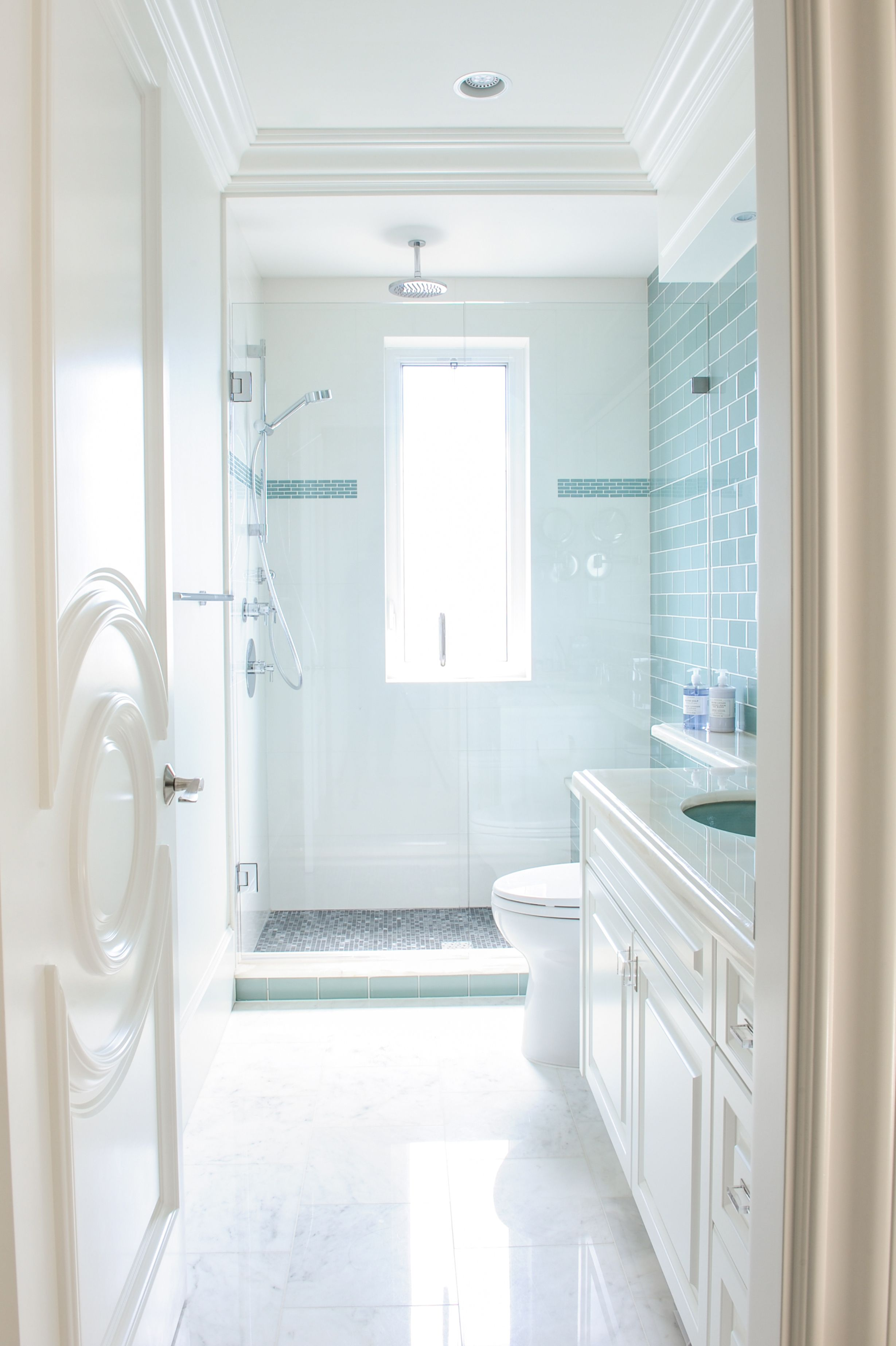 Bathroom designed by Enviable Designs - A central window opening ...