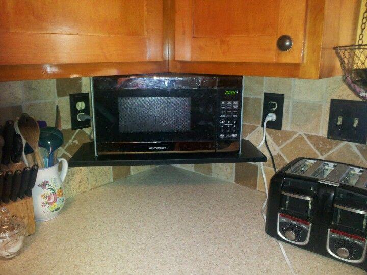 suspended corner microwave shelf that