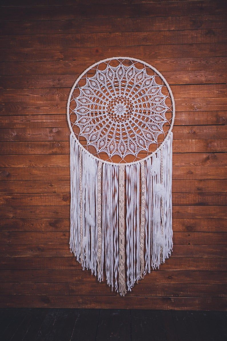 Would this white giant dream catcher wall hanging melt your heart? Absolutely. This is a beautiful handcrafted boho wall art piece that will bring peace and serenity to your living room. Consider this large dream catcher, if are looking for a gift for a boho lover. Amazing wall art for a dream bohemian home. Pure beauty.  #dreamcatcher #dream catcher #bohodecor #bohohome #girlfriendgift
