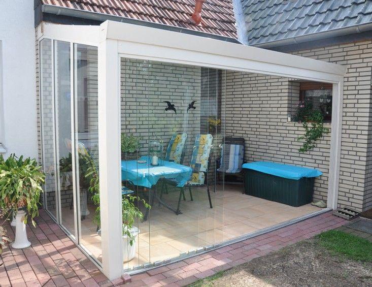 Veranda completa con fronte in scorrevoli in vetro e laterali in vetrate fisse senza timpano nella