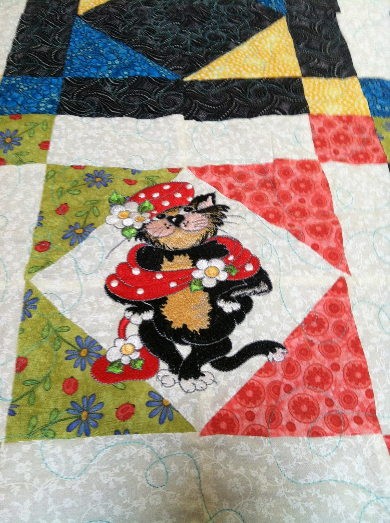 Embroidered Cat on Quilt