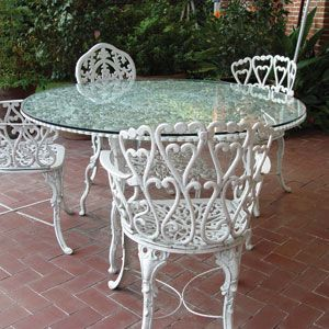 Wrought Iron Chairs With Upholstered Cushions At An Outdoor
