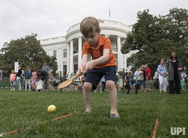 A Child Participates In The White House Easter Egg Roll On The South Lawn Of The White House In Washington D C On April White House Easter Egg Egg Rolls Eggs
