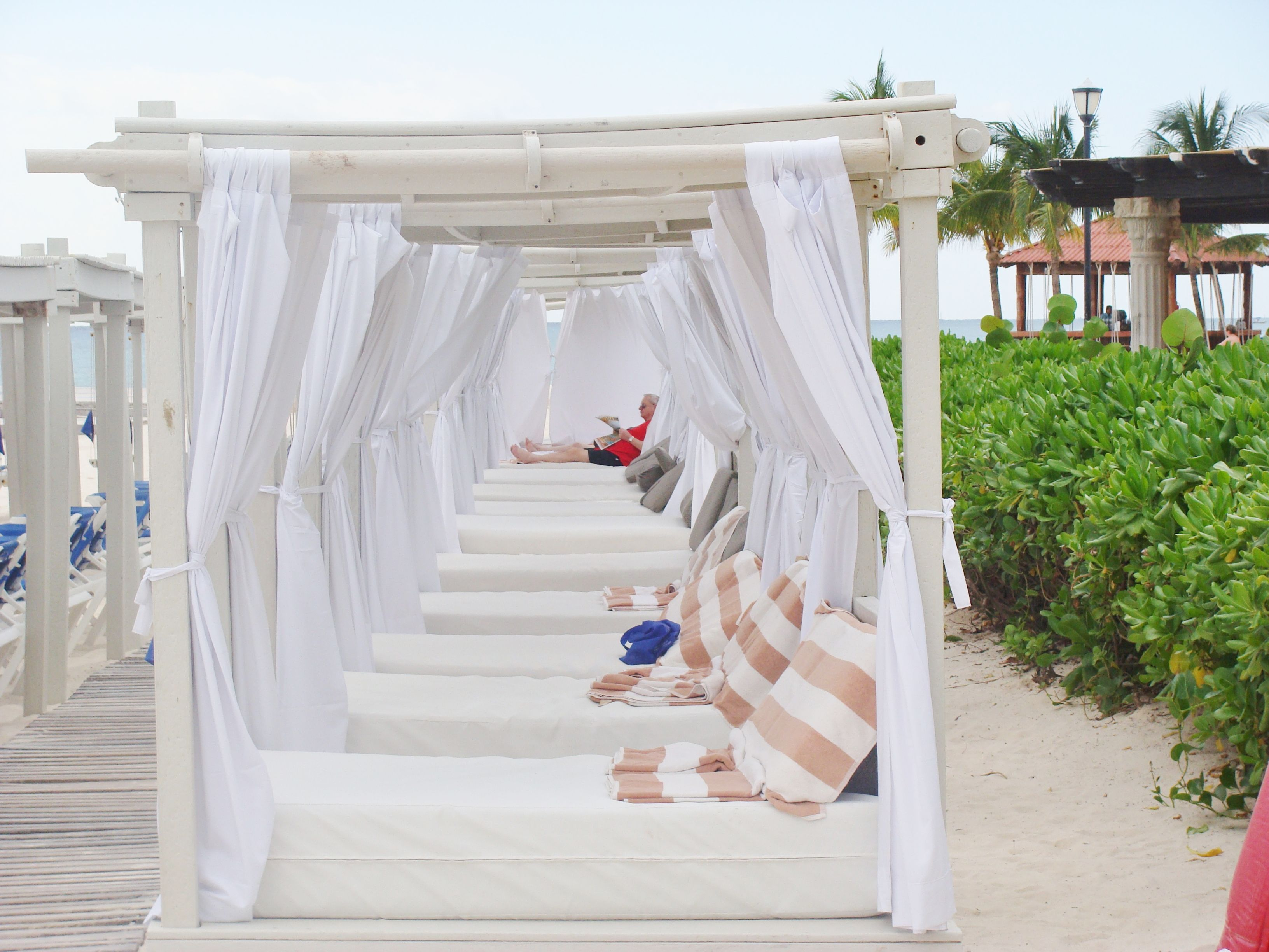 Pick your beach bed, next meet your beach butler, order your beverage of choice then settle in for a romantic and relaxing one-on-one day with someone special. We'll take you there, 888-696-4202, Wild Side Destinations, Director of Romance PJ!