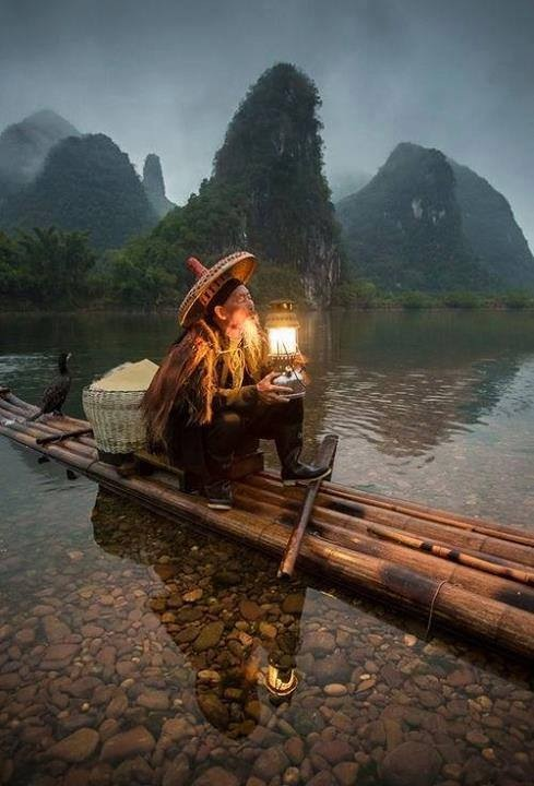 9f3f75ff989 Old man fishing on the Li River in China