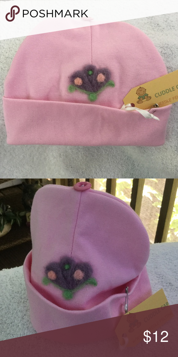 BABY CUDDLE CAP BEENIE HAT. NWT. PINK.  FLOWER Pink cotton BEENIE cap with wool needle felted flower.  Adorable and NWT. Has a matching pink button on top. Perfect for fall or winter. Accessories Hats