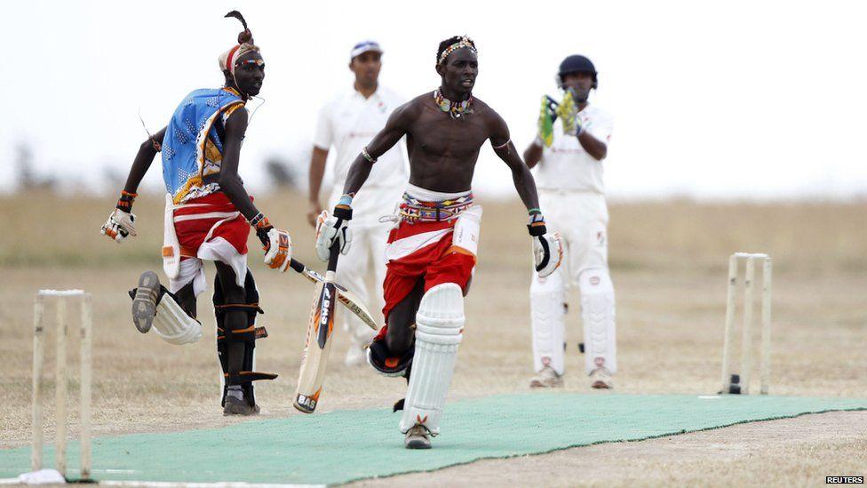 Sonyanga Olengais (C), captain of the Maasai Cricket Warriors, and his teammate Thomas Takare run between the wickets - Thursday 6 June 2013